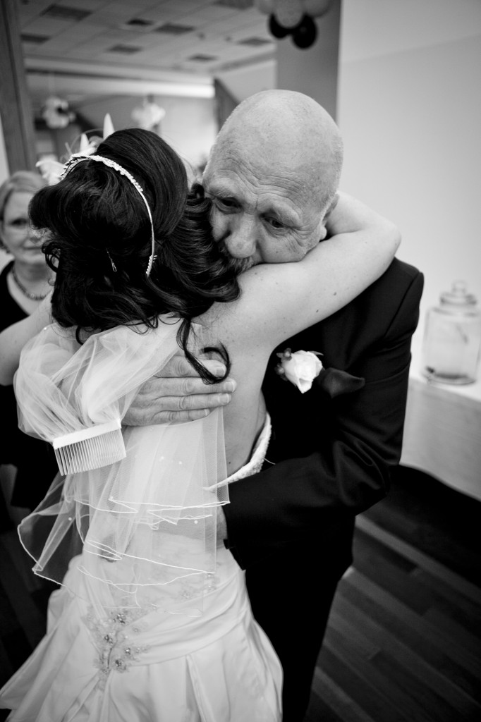 Father and bride hugging after the ceremony